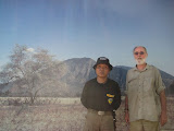 Nick Hughes and National Park Guide before a 'backdrop' of Gunung Baluran (October 2012)