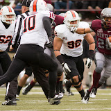 Grizzly running back Peter Nguyen is pursued by Bengals Sage Warner (#62), Taison Manu (#10), and Kimo Makaula as the referee tries to get out of the line of fire.  Nguyen was Montana's rushing leader, with 107 yards on 11 carries and one touchdown.  Washington-Grizzly Stadium in Missoula, Mont., October 27th, 2012.