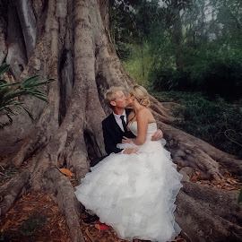 In the garden ...  by Alan Evans - Wedding Bride & Groom ( wedding photography, lovers, melbourne wedding photographer, park, aj photography, wedding dress, pink shoes, marriage, melbourne botanic gardens, tree, wedding, wedding day, bride and groom, bride, groom, bride groom )