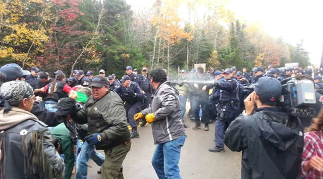 RCMP pepper spray indigenous Elsipogtog Mi'kmaq First Nation protesters as they blockaded a New Brunswick fracking exploration site. Photo: exposingthetruth.co