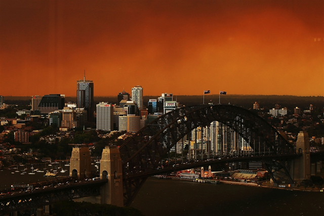 A view across Sydney Harbour Bridge and the city's central business district on 17 October 2013. Sydney is shrouded in a haze of smoke as wildfires rage in the western suburbs of Springwood, Winmalee and Lithgow. Brendon Thorne / Getty Images