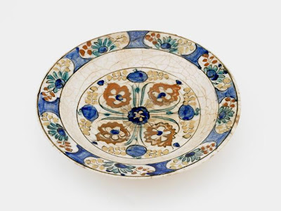 Plate | Origin:  Iran | Period: 17th century  Safavid period | Details:  Not Available | Type: Stone-paste painted under glaze | Size: W: 8.3  cm | Museum Code: S1997.59 | Photograph and description taken from Freer and the Sackler (Smithsonian) Museums.