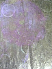 gelli printed papers gold paint w rings then cleared plate