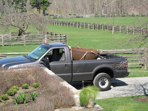 Back at the farm - now we just have to figure out how to get this thing off of the pickup.