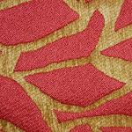Tkanina obiciowa z efektem metalicznym. Motyw roślinny - liście. Czerwona, złota.