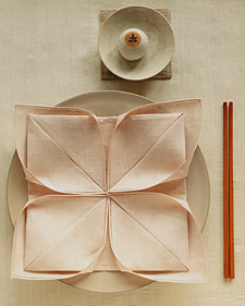 Ahhhh...the lotus: http://www.marthastewart.com/article/napkin-folding-lotus