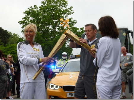Olympic Torch Relay 2012 - Crewe - flame is transferred on Crewe Green Road