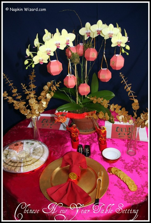 chinese new year table setting with orchids and paper lanterns