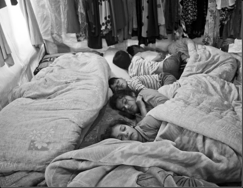Syrian children sleeping inside their family's tent in the Bekaa Valley, Lebanon. (Moises Saman/Magnum Photos for Save the Children)