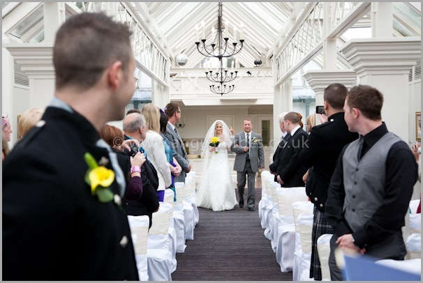 Jo comes down the aisle for her wedding at the landmark dundee