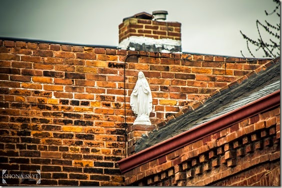 Statue of the Virgin Mary high up on a roof in Souland, St. Louis MO