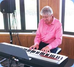 Ian Jackson playing the Club's Korg SP-250 digital piano. Photo courtesy of Michael Bramley