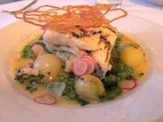 Halibut with petits pois a la Francaise, lardo, radish, baby gem and jersey royals