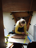 Erin making a mock up of the anchor well bulkhead before we cut it,