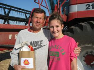 "4-H'er and County Council member Bridget Nebel with farmer John Kleese working in a bean field where he stopped for his ""Stay Safe, Take a Break"" bag.  Photo courtesy:  The Washington County Extension"
