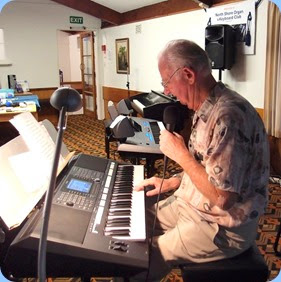 Peter Jackson played both the arrival music and a performance slot. He played some pieces straight and sang along with his Yamaha PSR-S950 for some other numbers. Photo courtesy of Dennis Lyons.