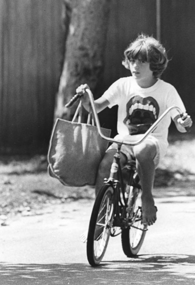 Young-John-Kennedy-Jr-on-a-bicycle