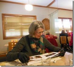 Joan looking at book