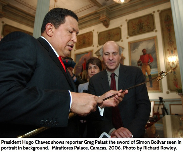 President Hugo Ch&agrave;vez shows reporter Greg Palast the sword of Sim&oacute;n Bolivar, seen in portrait in background, Miraflores Palace, Caracas, 2006. Photo: Richard Rowley