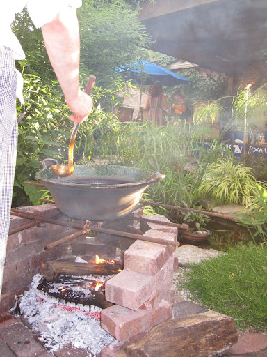 A fire pit was built just for this bubbling pot of mole.