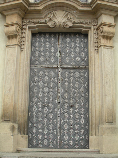 The detailing makes this door look almost armor-like. (Prague)
