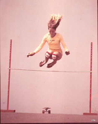 Robin with hair flying going over the high jump at La Costa!