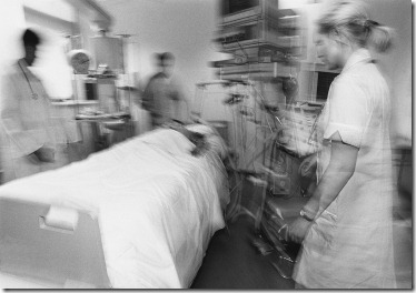 Medical Staff Tending a Patient ca. 1980s-1990s