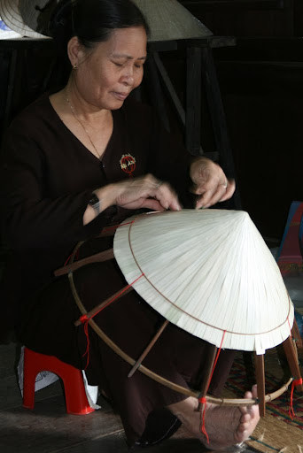 The famous conical hats are incredibly cheap everwhere, but require time and intricate effort to weave between each rice stalk.
