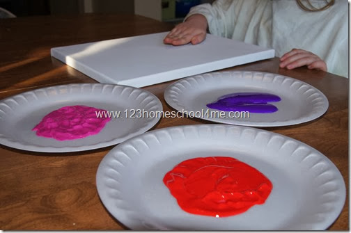 get a canvas or paper and washable paint
