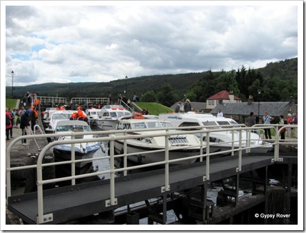 Nine cruisers in one lock going down the Caledonian canal flight at Fort Augustus.
