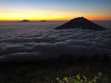 Merbabu, Merapi and Sumbing (right) rising above the clouds at dawn, as seen from Sindoro (Chris Whiting, October 2012)