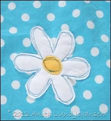 Detalj kjole blomst
