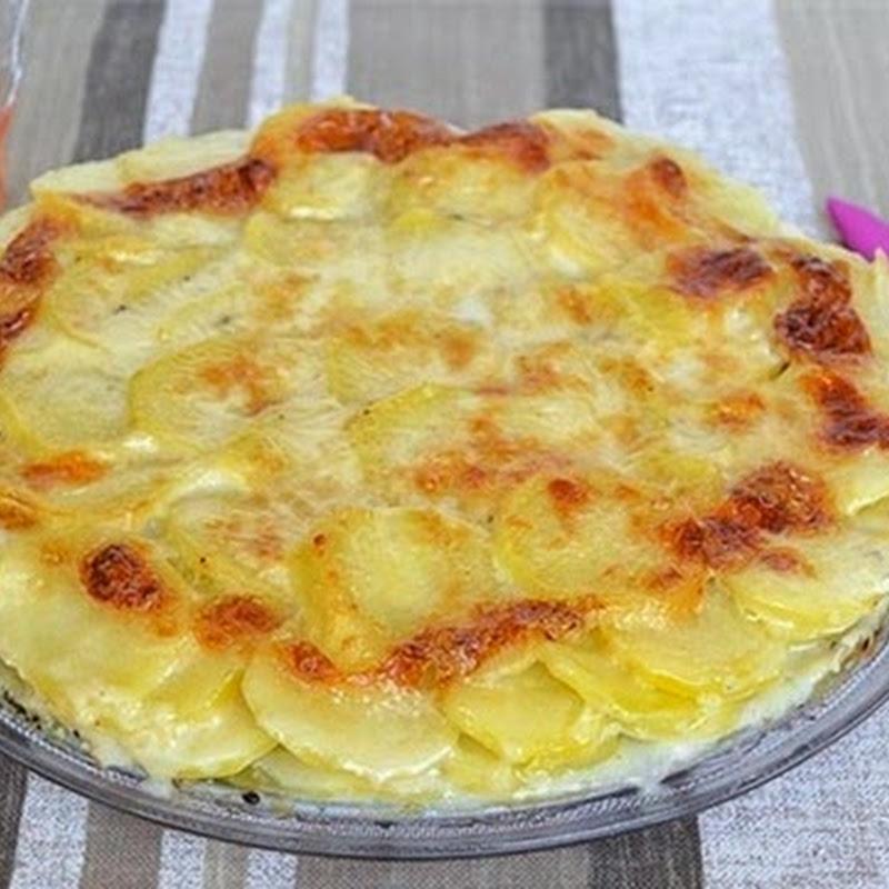 Πατάτες  ογκρατέν  με παρμεζάνα και ζαμπόν