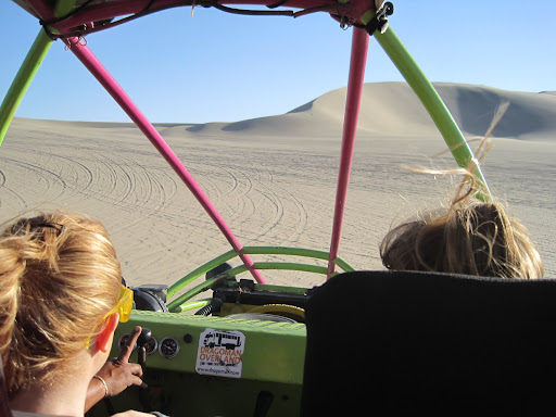 Screaming through the sand dunes in the dune buggy