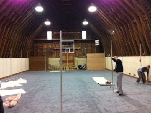 Once the carpet was laid, pipes were put up so fabric could be draped along the perimeter.