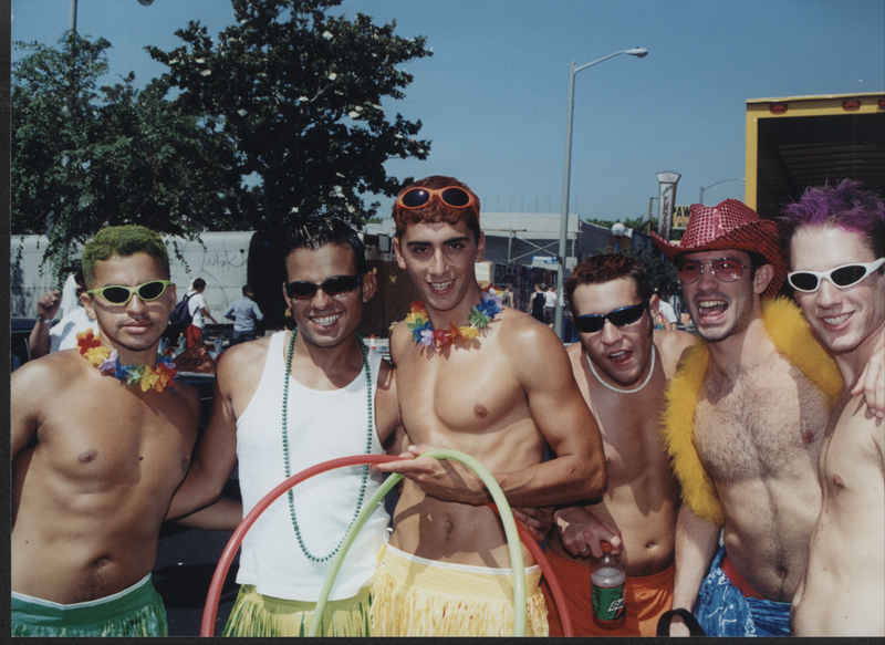 Six men celebrating at the Los Angeles Christopher Street West pride parade. June 17, 2001.