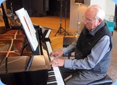 Rob Powell playing the grand piano. Photo courtesy of Dennis Lyons.