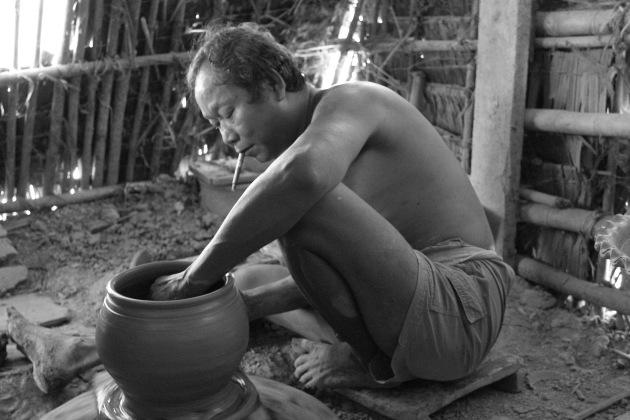 A Twante, Burma Pottery man at work