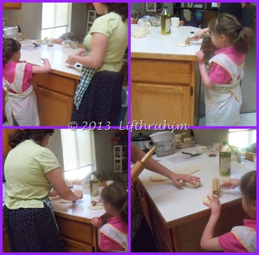 Two sisters rolling out bread dough to shape for loaves.
