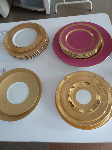 Four place settings that are completely different from each other: Philippe Deshoulieres 