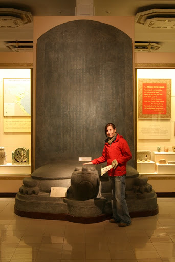 Lynette in front of a huge tortoise mounted stelae; they&#039;re fond of these.