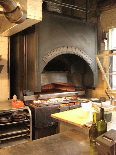 This open-fire oven is visible from the dining area of the restaurant.