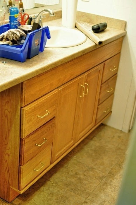 A super simple and inexpensive tutorial on how to transform honey oak cabinets to dark espresso cabinets. #DIY