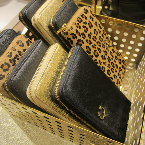 Clutches covered in fur and leather.