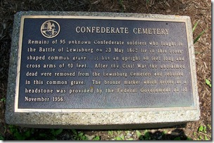 Confederate Cemetery memorial marker in front of the fence of the cemetery.