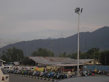 The highest peak of the Cyclops range in the distance, as seen from Sentani airport (Daniel Quinn, January 2011)