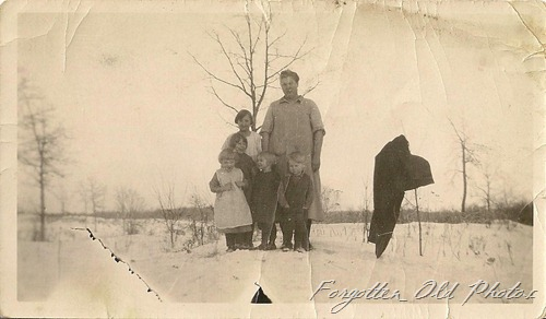 Kids and Mom in a snowbank Solway antiques