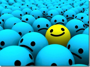 yellow_smiley_in_group_of_blue_smiley