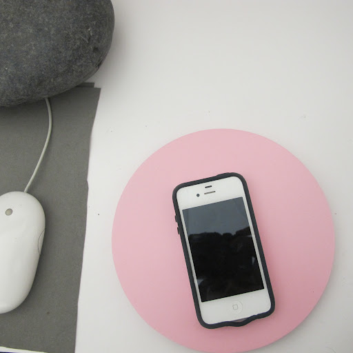 My iPhone rests on this simple painted wooden circle.