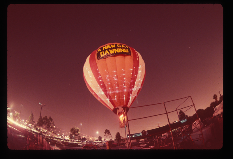 Hot air balloon rising aboive the Los Angeles Christopher Street West pride parade. 1982.